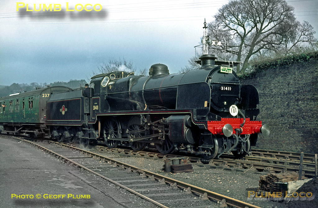 """SECR Maunsell """"N"""" Class 2-6-0 No. 31411 is in charge of the joint RCTS/LCGB """"The Sussex Downsman Railtour"""", visiting the site of the old station at Lewes before making its way to Brighton. Sunday 22nd March 1964. Slide No. 549."""