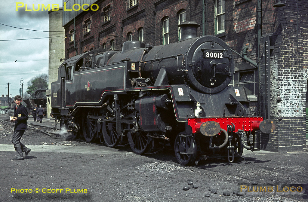 BR Standard 4MT 2-6-4T No. 80012 is newly ex-works in fully lined black livery, simmering in the shed yard at Eastleigh MPD. It is not carrying a shedcode plate but as it has SR style lamp irons it may well have been a locally-based engine. Saturday 9th May 1964. Slide No. 650.