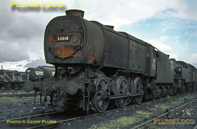 Bulleid Q1 Class 0-6-0 No. 33018 looks as though it may have been in use recently as its wheels only have superficial rust on them, but it may now be dumped. It is standing in front of an unidentified LMS Ivatt 2-6-2T and a BR Standard 2-6-4T at Eastleigh shed on Sunday 27th July 1965. Slide No. 1495.