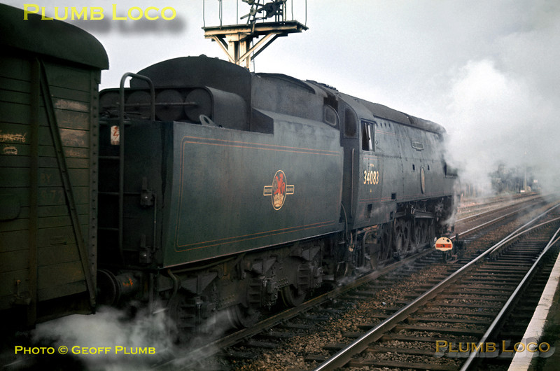"SR unrebuilt Bulleid ""Battle of Britain"" Class 4-6-2 No. 34083 ""605 Squadron"" restarts its Plymouth to Brighton train away from the station stop at Cosham, Tuesday 18th February 1964. Slide No. 526."