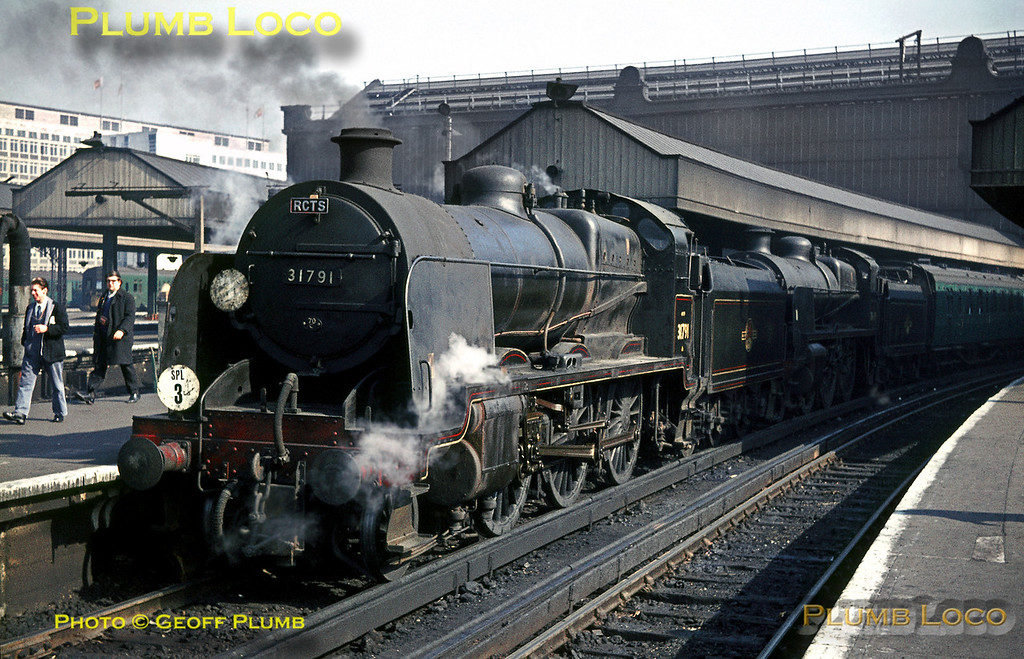 """""""U"""" Class 2-6-0s Nos. 31791 & 31639 are at the head of the RCTS """"Longmoor Military Railway"""" Railtour at Waterloo station on Saturday 30th April 1966. They worked the train as far as Woking where LMR WD 2-10-0 No. 600 """"Gordon"""" took over for the run to Liss and onto the Longmoor system. Slide No. 1960."""
