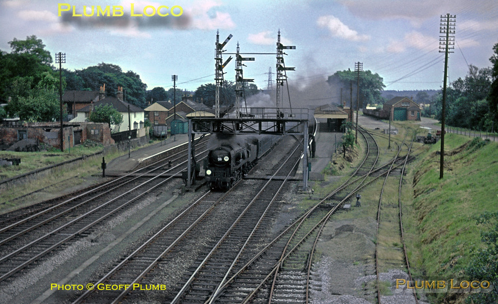 """SR rebuilt Bulleid """"Battle of Britain"""" 4-6-2 No. 34109 """"Sir Trafford Leigh-Mallory"""" rushes through Winchfield station on the down fast line with an express from Waterloo to Bournemouth on Saturday 4th July 1964. Slide No. 788."""