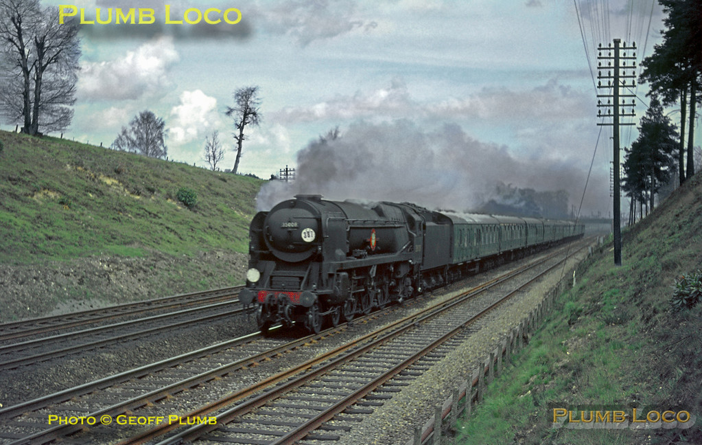 "Foremer Southern Railway Lines. Bulleid rebuilt ""Merchant Navy"" 4-6-2 No. 35008 ""Orient Line"" races south passing Fleet with a down express from Waterloo to Bournemouth, Saturday 24th April 1965. Slide No. 1292."