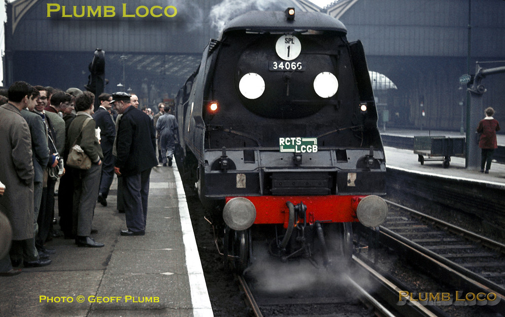 """On Sunday 22nd March 1964, the RCTS and LCGB ran a joint special, """"The Sussex Downsman Railtour"""" from London Waterloo via diverse routes to Brighton and return to London Victoria. Unrebuilt Bulleid """"Battle of Britain"""" class 4-6-2 No. 34066 """"Spitfire"""" awaits departure time at Brighton, admired by some of the tour participants. Slide No. 557."""