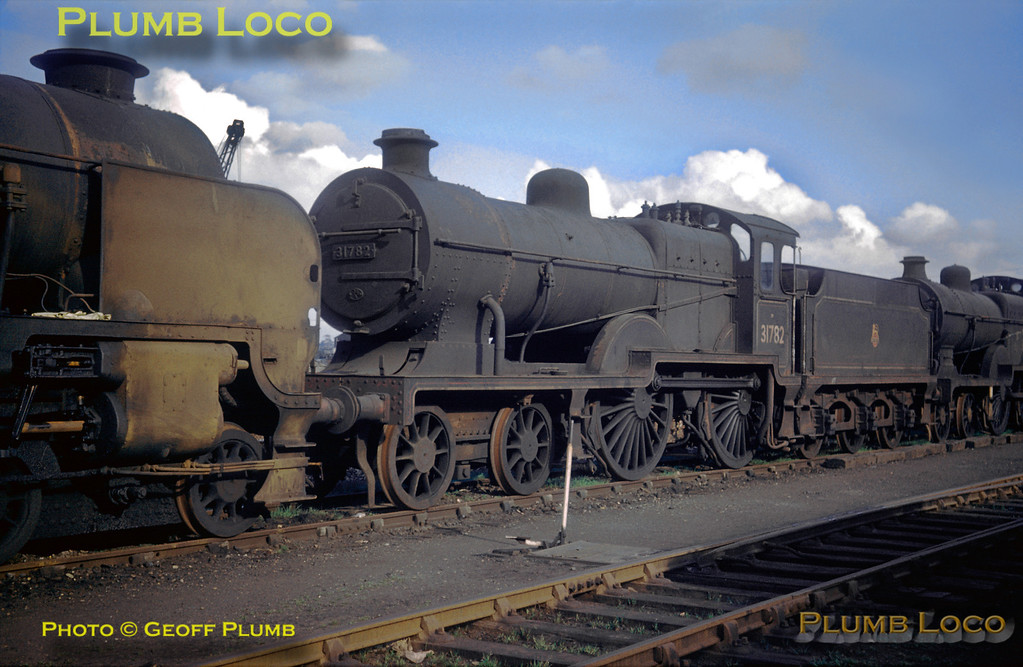 """From the Geoff Plumb Collection of original slides. Maunsell L1 class 4-4-0 No. 31782 was built in April 1926, North British No. 23363, it was withdrawn in February 1961 from 70A Nine Elms MPD and scrapped at Ashford Works in May 1961. It is carrying a 74A shedcode plate - Ashford MPD - but this changed to 73F in October 1958... The loco is facing """"Schools"""" class 4-4-0 No. 30933 """"King's Canterbury"""" and is ahead of D1 class 4-4-0 No. 31487. They are standing on the scrap line at Ashford Works during an RCTS visit on Sunday 19th March 1961. Photographer unknown, but possibly E.A.S. Cotton. Collect Slide No. 29409."""