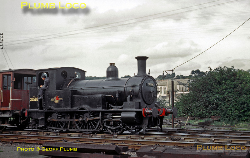 From the Geoff Plumb Collection of original slides. One of the three surviving Beattie Well Tanks, class 0298 2-4-0WT 0P, No. 30586 is busy doing some shunting in the yard at Wadebridge station on an unknown date in the late 1950s or early 1960s. This loco differed from the two others in that it had square splashers as opposed to rounded. The other two locos survived into preservation, but sadly, not this one. Photographer unknown. Collect Slide No. 1917.