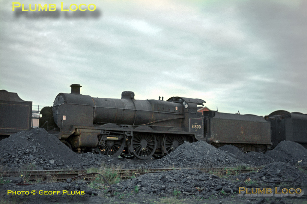 SR U Class 2-6-0 No. 31800 is dumped out of use at Eastleigh depot, its motion already stripped down prior to its final move for scrapping. It was one of the class whose SR style chimney was replaced with BR standard types in later years. Saturday 6th November 1965. In front is sister loco 31627 and behind an unidentified BR Standard loco. Slide No. 1706.