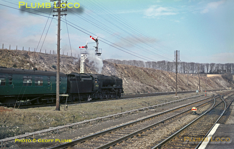 "SR Bulleid rebuilt ""West Country"" 4-6-2 No. 34026 ""Yes Tor"" is passing through Micheldever station with an up express from Bournemouth to Waterloo on Saturday 13th March 1965. Slide No. 1216."