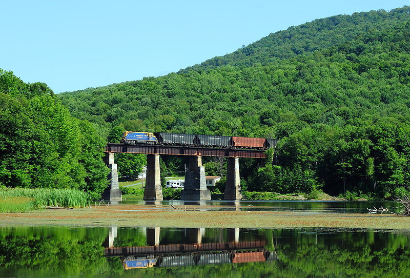New England Central ``chip train`` Arrowhead Mountain Lake, Vermont.