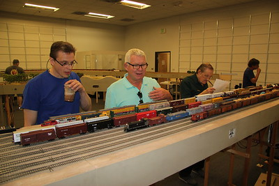 Gregg Fuhriman, Mike C., and Barry Draper figuring out the three local trains to build in Mojave Yard.
