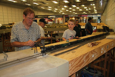 Skip Martin running an express reefer train and Ethan Risdon watching it.
