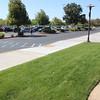 Parking lot wheelchair ramp on sidewalk.