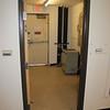 "Looking from the room towards the back exit door, both doorways are 33"" wide."