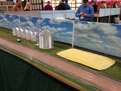 Grain elevator scene with open corn pile