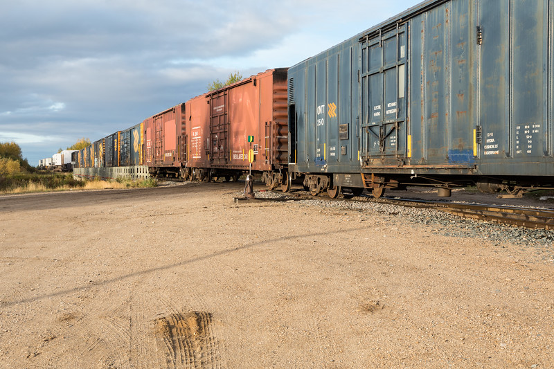 Freight 419 arrives in Moosonee. Boxcars, prefab homes on flatcars and trailers on flatcars.