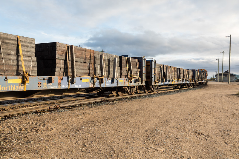 GP38-2 locomotives 1804 and 1806 lead freight 419 into Moosonee. Bulkheads with ties.