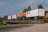 Freight 419 trailers on flatcars crossing Store Creek in Moosonee.