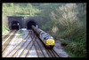 On 07-04-1997 37902 storms out of the Newport Tunnels at 09.31 with 6B96 09.15 Llanwern O. I. - Tidal Sidings