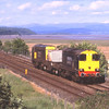 20302 and 20304 pass Kents Bank on their return from Heysham, 5/6/2013