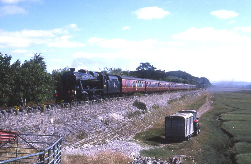 "8F 48151 approaches Grange with a Carnforth to Sellafield Lancashire Railtours charter ""The Brief Encounter Special"", 16/7/2005."