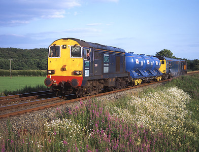 20309 top and tails a weedkiller train with 20306 near Black Dyke 7/7/05.