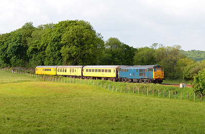 A Carnforth-Derby via Carlisle measurement train is propelled past Silverdale by 31106 5/6/13.