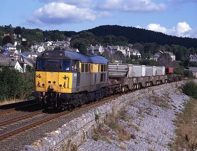 31188 hauls a flask train along the sea wall near Grange 30/8/97.