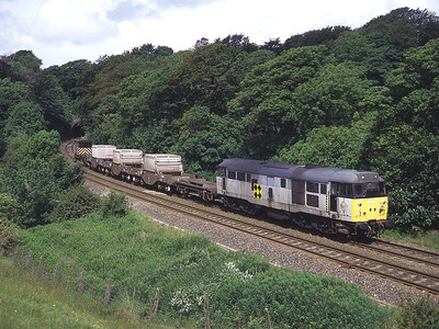 For many years a pool of Crewe based 31s worked most of the flask trains, complete with barriers and a brake van.  31319 leaves Furness Abbey tunnel on 6/7/96.