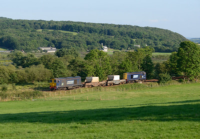 Running around 1½ hours late due to loco problems 20304 and 20312 pass Silverdale with the Heysham-Sellafield flasks, 24/7/14.