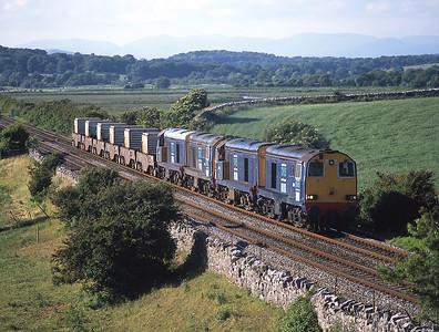 20314+20308+20312+20304 head a flask train near Leighton Moss .16/6/04
