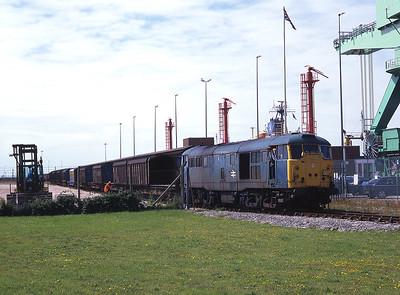 31450 shunts vans at Barrow Ramsden Dock 22/7/98.
