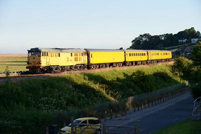 31233 propels a Carnforth to Derby via Barrow and Carlisle measurement train near Grange 11/7/14.