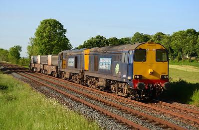 20302+20304 haul the morning Crewe-Sellafield flask train near Silverdale 8/6/13.