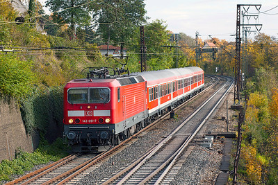 143 091 heads a Stuggart to Ulm stopping service downhill approaching Ulm. This location is alongside the Brauerei Golden Ox brewery. 26th October 2009.