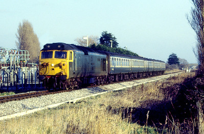 50007 'Sir Edward Elgar' passes the SWEB yard on the entry to Weston-super-Mare with a stopping service from Bristol. 1980's
