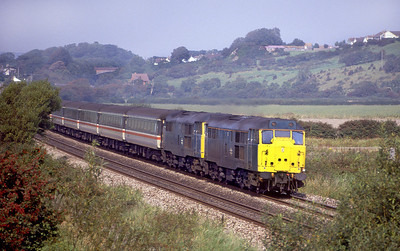 In the summer of 1988 a pair of 31's head west at Accommodation Road, Bleadon.