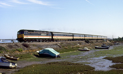 With a MK3 sleeper in the consist 47833 passes Cockwood Harbour with the 12.39 Penzance to Paddington. 25th August 1991.