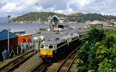 26007 & 26001 depart from Oban with 1Z48 15.48 Oban to Waverley Railtour. 23rd August 1992.