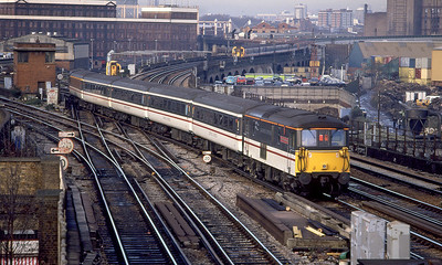 73210 'Selhurst' pushes a Gatwick Express past Wandsworth Road. 9th December 1994.