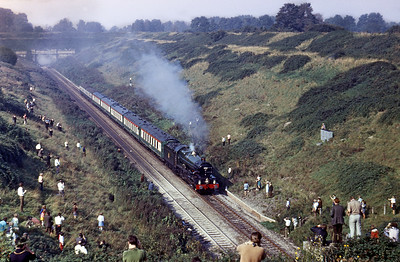6000 King George V breaks the steam ban on Saturday October 2nd 1971 with a railtour from Hereford to Tyesley climbing away from the Severn Tunnel. Not too many people on the line side!