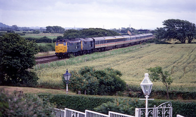 A pair of 31's approach the site of Bleadon station with a returning northbound Saturday holiday extra. 1980's.