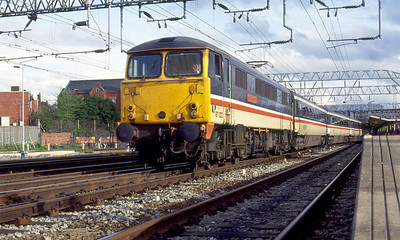 87022 'Cock o' the North' departs from Crewe on a Euston to Liverpool service. 20th April 1993. After release from Virgin Trains 87022 had short spells with both DRS & GBRF before being exported to BZK Bulgaria in November 2008 as 87022-0
