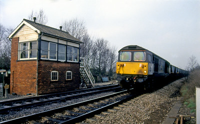 A Class 58045 passes Appleford Ground Frame with a Didcot Power Station MGR. 29th February 1992.