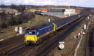 73109 'Battle of Britain 50th Anniversary' passes Eastleigh with 423's 3529 & 3530 in tow as a pair of 47's prepare to run back into the station. 17th February 1995.