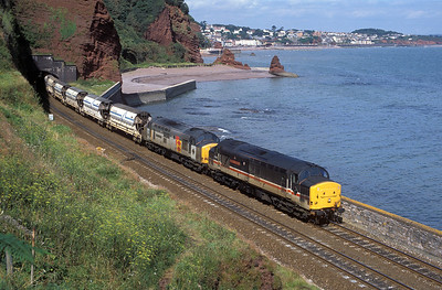 37420 'The Scottish Hosteller' & 37675 'William Cookworthy' pass Horse Cove with the 08.20 Bescot to St. Blazey empty china clay service. 24th August 1991.