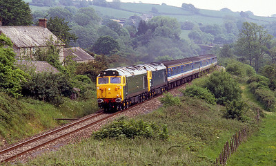 50007 'Sir Edward Elgar' & D400 head the 10.59 Waterloo to Exeter St. Davids under the A35 and up the bank at Widworthy on the Class 50 final running day. 24th May 1992.