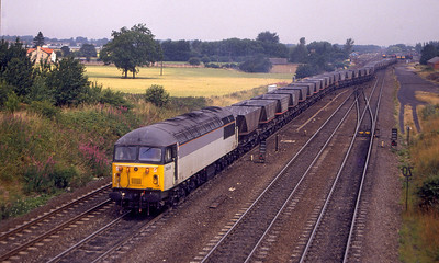 56011 departs from Milford Sidings with an empty MGR. 21st July 1994.