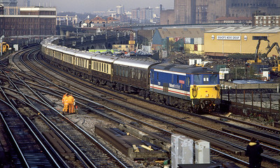 73129 'City of Winchester' passes Wandsworth Road with the Venice Simplon Orient Express on the exit from London. 9th December 1994.