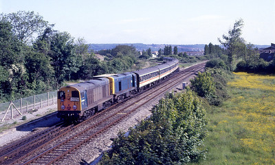 F & W's Railtour 'Chopper Topper' comes off the Weston-super-Mare loop line at Uphill Junction. Running as 1Z36 from Wolverhampton with 20054 & 20011 providing the power. The tour should have reached Penzance but due to derailment of a Class 37 it terminated at Truro. 8th June 1986.