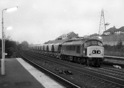 In the failing evening light a Class 45 heads a train of CDA's westbound through Longbridge station. Date unknown.